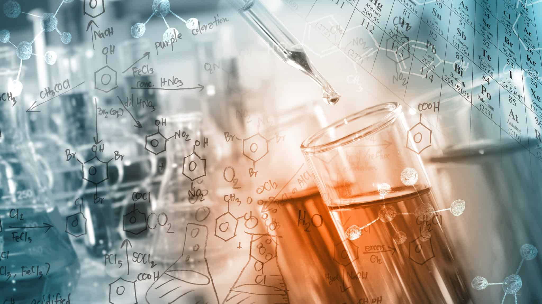 researcher dropping the clear reagent into test tube with periodic table and chemical equations background, for reaction testing in chemical laboratory.